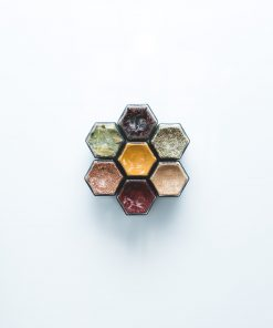seven spice jars in flower arrangement